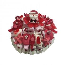 Un gâteau de bonbons avec un père Noël en sucre
